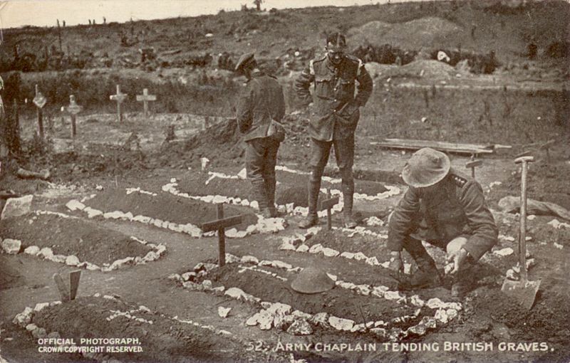 800px-Daily_Mail_Postcard_-_Army_chaplain_tending_British_graves