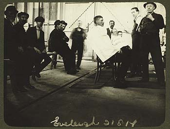Railway_staff_receiving_haircuts_(4865044474)