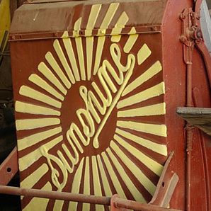 Sunshine_Harvester_Works_logo_on_a_harvester